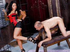 Stripped thrall lad stands still in front of black haired latin domina Kiara Mia. That babe makes him lick her legs and feet in advance of she bares her massive tits and big juicy ass. That babe spreads her big buttocks right in front of her thrall man.