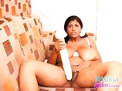 Kristina Milan playing with a huge dildo