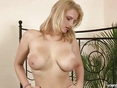Busty blonde masturbating