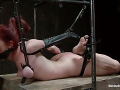 Chastity is a fucking slut. She has been tied up and laid on her belly on that wooden table. The mistress works hard at her shaved pink cunt with a dildo and a vibrator. She wants to be sure that the whore will get enough fucking and her pussy won't need some soon. Enjoy how this cunt is punished and pleased