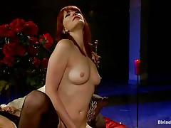 divine redhead whore fucking a man with a strap on