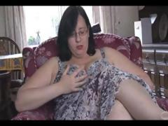 Fat mature brunette with giant tits and ass sticks vibrator in her pussy
