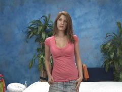 Tender brown haired girl Karina in pink t-shirt and blue jean mini skirt does some modelling in the massage room with her clothes on before massage. Do you like her cute face and sexy legs?