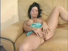 Raven haired busty Sabrina Dotee spreads her legs and strokes her hairless pussy like crazy in this solo scene. That babe can't stop rubbing her bare snatch. Sabrina Dotee puts her hands on her fake boobs from time to time.