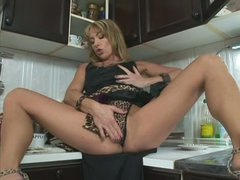 Long legged milf Tara Romain takes Steve's cock in her mouth just now after masturbating with dildo on the kitchen counter. She sucks his schlong like insane and then offers her dripping wet pussy to hot guy.