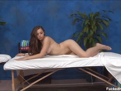 Long haired charming brunette girl Tiffany with moist milk shakes and fine butt takes off her bra and panties in flirtatious manner. Hot bodied chick is naked and sexy on massage table.