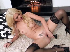 Lovely blonde porn star Alexis Ford in black nylons and high heels displays her nasty parts and then toys her twat on the floor by the fireplace. She does it for you to watch and enjoy.